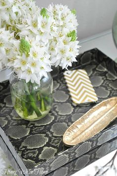 Snakeskin duct tape + shoebox lid = Tray