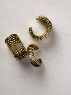 dinosaur-designs-atelier-collection-brass-gold-bangle-cuffs.jpg