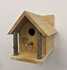 Cedar Birdhouse Handcrafted with natural wood pillars. Unique
