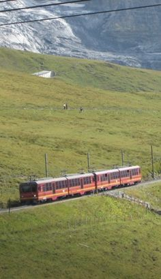 Taking a mountain train to Grindelwald after hiking in the Swiss Alps near the famous Eiger Mountain.