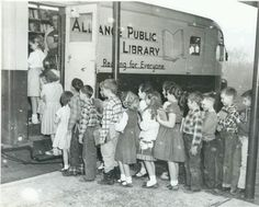 The bookmobile was one of my favorite parts of summer.  We had no library in my little rural Iowa town, so the arrival of the bookmobile was a major event.  So familiar, even down to the clothing these children are wearing!