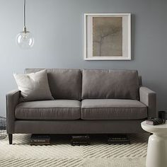 "Heath Sofa - Grand #westelm  Overall product dimensions: 86.5""w x 40.5""d x 34.5""h Seat depth: 20"". Interior seat width: 78.5"". Back height: 30.75"". Clearance: 6"". Diagonal depth: 30.5"". Cone leg: round taper; Tapered leg: square taper."