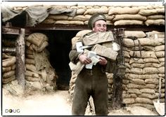 Royal Artillery man receiving Christmas Gifts on the Western Front, somewhere in France.