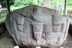 Mayan Stelae at Quirigua – Guatemala - Atlas Obscura: AnotheR Mayan carving that appears technological to me. This person seems to be peering out of a machine or amechanical craft.