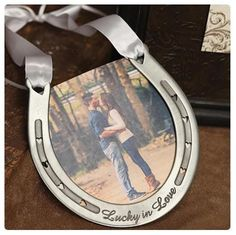 """The genuine pewter horseshoe hangs from a pretty white satin handle and is engraved with the words """"Lucky in Love."""" Heart-shaped holes line the horseshoe. Horseshoe Ring, Horseshoe Crafts, Lucky Horseshoe, Horseshoe Wedding, Horseshoe Ideas, Wedding Day Tips, Wedding Gifts, Dream Wedding, Wedding Reception"""