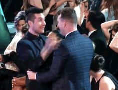Dan Smith of Bastille, hugging Sam Smith at the Grammys---'That was INSANE'