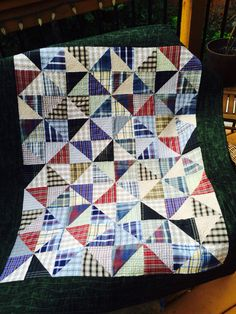 A quilt made with my dad's old shirts for my cousin Brenda