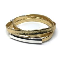 BOHO Leather Wrap Bracelet, Leather Jewelry, Cuff Bracelets, Gift for Her, Gold Leather, Triple Wrap Bracelet, Bangles, Cuff, Tubes, Hook    Wraps by Renzel's triple leather wrap bracelet combines gold leather with a twist on the wrap beaded bracelet trend. The wrap bracelet is made with 100% flat folded leather cord and silver plated (in the USA) with flat metal tube creating a sophisticated look. Wear it solo or great for stacking with your other jewelry.    A strong magnetic clasp has a…