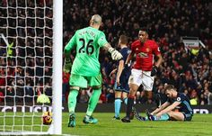 Middlesbrough defender Calum Chambers (right) appears dejected as Martial runs to grab the ball after scoring