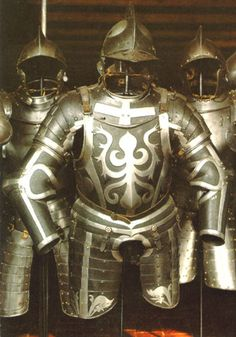 """16th cen. style of armour called """"black and white"""" was mostly used in a military context to distinguish officers from troopers. The common soldier getting mostly all black or all russet armour. The officers getting black and white armours of varying complexity to show degree of rank. The highest ranks and nobility getting the polished armour."""