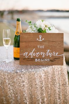 The Adventure Begins sign perfect for a nautical wedding infused with glam. Photography: Natalie Franke - nataliefranke.com, Calligraphy by http://lhcalligraphy.com/  Read More: http://www.stylemepretty.com/2014/06/03/coastal-glamour-a-nautical-inspired-photo-shoot/