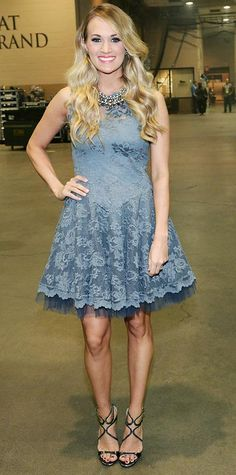 Look of the Day › April 8, 2014 Carrie Underwood doled out a pretty look at the ACM Presents: An All-Star Salute to the Troops in a flirty gray lace tulle dress that she accessorized with a Stella & Dot statement necklace and black strappy stilettos.