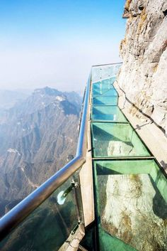At least 4000 feet in the air a three-foot-wide walkway clings to one face of Tianmen Mountain in Zhangjiajie, China, above a rocky ravine. With a glass bottom, the tourist attraction provides a crystal-clear view of where one wrong step could take you.