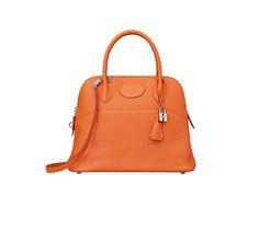 "Bolide Hermes bag in orange taurillon clemence calfskin leather Measures 12""x 9.5"" x 4.5"". Shoulder strap and handstrap. Silver and palladium hardware."