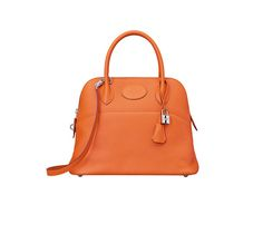 "Bolide Hermes bag in orange taurillon clemence calfskin leather Measures 12""x 9.5"" x 4.5"". Shoulder strap and handstrap. Silver and palladium hardware."