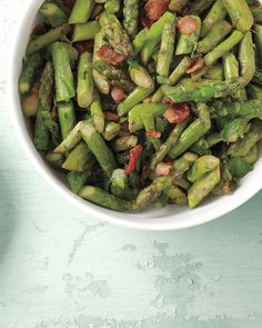 Savory bacon pairs well with the sweet, grassy taste of sauteed asparagus.