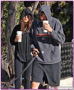 Ashton Kutcher and Mila Kunis weren't in much of a mood to be photographed today.  The couple were spotted taking their dog for a walk while out in Hollywood this afteroon but the lovebirds weren't exactly thrilled that the paparazzi spotted them.