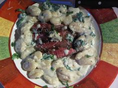 Keith Szczepanski's pepper crusted flank steak with potato gnocchi and wilted spinach in gorgonzola cream sauce.  YUM!