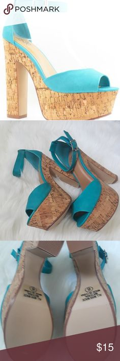 Turquoise Peeptoe Strappy Faux Wooden Chunky Platf These sexy chunky platform faux wooden heels include a leather fabric upper in a strapy buckle design, stitched detailing, open toe, smooth lining, and cushioned footbed. Approximately 5 1/2 inch heels and 2 inch platforms. Speed Limit 98 Shoes Platforms