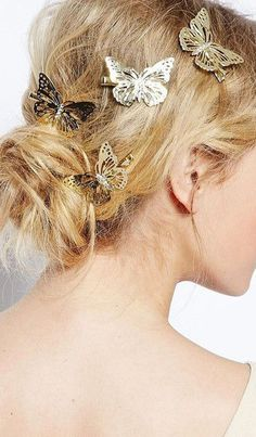 messy hair bun with butterfly hair clips.