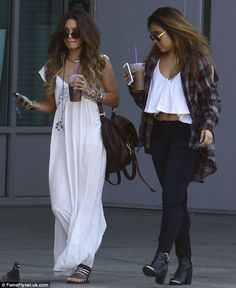 Sisterly bond: The 24-year-old actress Vanessa Hudgens utterly dazzled as she breezed down the street in her plunging gown and sandals while heading out for a spot of lunch in Hollywood, California, alongside her sister Stella Hudgens