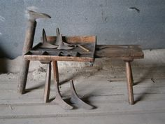 A Century Primitive Cobblers Bench. Constructed in Pine with Ash legs ,seat and work tray. Original condition apart from its missing its drawer but still with build up of crust in the compartments .