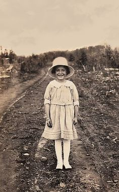 +~+~ Vintage Photograph ~+~+  Surrounded by dirt but all pretty in white