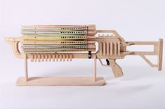 This rubber band machine gun shoots 14 rubber bands per second. Its ammo is a barrel of 672 rubber bands.
