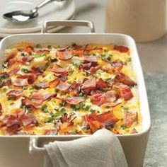 Creamy Make Ahead Mashed Potatoes Recipe from Taste of Home -- Creamy mashed potatoes get even better when topped with a savory trio of cheese, onions and bacon! —JoAnn Koerkenmeier, Damiansville, Illinois