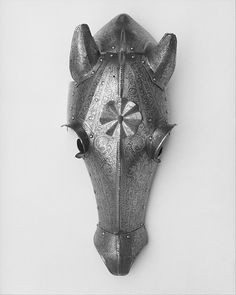 The horse armor is covered with etched ornament that includes undulating foliage, mythological creatures, winged putti, and heroes from Biblical and Classical history, such as David and Goliath and Marcus Curtius