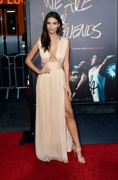 Emily Ratajkowski wears a pluging satin gown with a thigh-high slit and nude heels