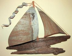 Driftwood and vintage metal sailboat. Read the story here: https://www.facebook.com/photo.php?fbid=701923013213531&set=a.367501199989049.84734.311262935612876&type=1&theater