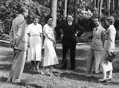 A gathering at Leni Riefenstahl's home. Leni is standing next to Hitler on his left. On Hitler's right is Joseph Goebbels and Goebbels' soon to be mistress, Lida Baarova. The other two are unknown