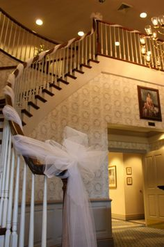 Tulle wrapped staircase railing by Sedgefield Florist in the foyer of Magnolia Manor, Colfax, NC.