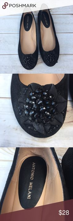 {Antonio Melani} embellished black flats. Nearly new {Antonio Melani} black flats. Nicely embellished with suede flower type design & black stones. Size 8 1/2 with a cushy footbed. Have a kind of silver shimmer in certain lighting. ANTONIO MELANI Shoes Flats & Loafers