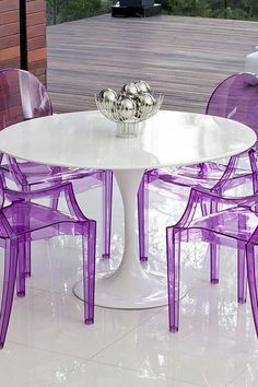 Tulip Round Fiberglass Dining Table - White and purple chairs