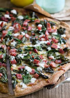 Crispy ham and spinach pizza.