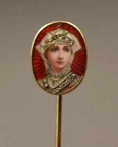 Gold, enamel and diamond portrait miniature pin, woman with jeweled neckline and Russian style headdress set with 21 small rose cut diamonds, and a necklace of gold filigree. Marked 07 and 12 on back. Gold tested 18K. Some tiny scratches to enamel surface. 1 3/4″ length. European, possibly Russian, late 19th century. Est. $300-$400.