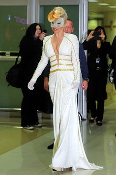 Well she didn't walk the red carpet (photo taken in an airport). Lady Gaga wearing Atelier Versace.