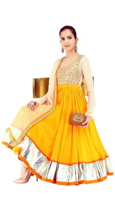 Feeling perky as the morning sun? Justify your emotions with this Ochre yellow and cream anarkali by Nikasha. Add Naina Balsaver coral jhumkis and gols uncut diamond ring to complete the look!    Shop at: https://www.perniaspopupshop.com/shop-the-look