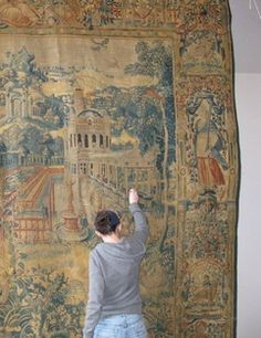 Cara Jordan working in our two-story tapestry conservation annex.