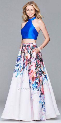 Dance and party all night long in this Cascading Floral Two Piece Prom Dress by Faviana. This two piece style features a mock high collar halter neckline with a stunning lace up back, The floral A-line skirt includes box pleating creating a fuller appearance and also includes in seam pockets! #edressme