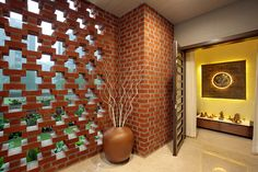 Pooja room / temple in a bungalow Perforated brick clad walls with the garden outside makes this a calm and serene pooja room befitting for a bungalow. Earthy Home Decor, Indian Home Decor, Brick Design, Wall Design, Decorating Blogs, Interior Decorating, Brick Feature Wall, Contemporary Bedroom Decor, Pooja Room Design