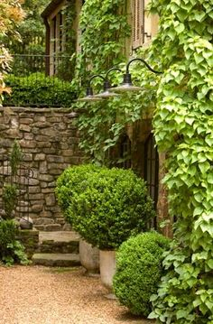 Beautiful combination of stone, pebbles and boxwoods.