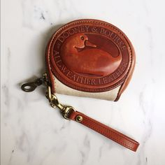 Vintage Dooney & Bourke Coin Purse✨ GORGEOUS, small, authentic D&B coin purse. Gently used but still in awesome condition! A couple gently signs of normal wear as display in pictures, but would be PERFECT with a leather cleaning/conditioning! Dooney & Bourke Bags Clutches & Wristlets