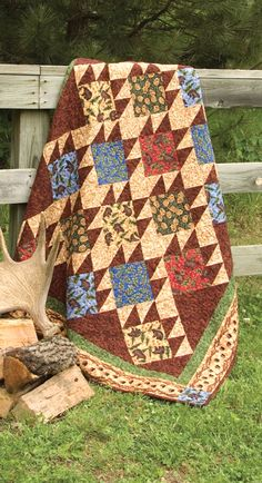 """Bear Paw Quilt"" from Granola Girl Designs Northwoods Flannel by Debbie Field. Love, love love this animal quilt pattern! Big bear paw patchwork blocks are set on point for a fast quilt project! Find it online: http://landauerpub.com/Granola-Girl-Designs-Northwoods-Flannel-Quilts-Projects.html"