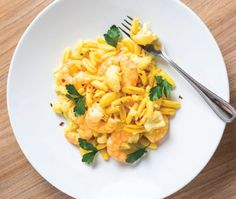 Best Bite: Fresh Saffron Cavatelli with Gulf Shrimp at Osteria Celli in Fort Myers - Gulfshore Life- May Photo by Vanessa Rogers Veal Cutlet, Arugula Salad, Red Sauce, Fort Myers, Bolognese, Macaroni And Cheese, Shrimp, Menu, Fresh