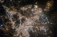 Just a few hundred kilometers away: Seoul, South Korea, a glowing hive of human activity welcoming in a new year.