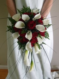 Teardrop shape bouquet with red roses, white calla lilies, leather ferns, and bear grass... Wedding ideas for brides, grooms, parents & planners ... https://itunes.apple.com/us/app/the-gold-wedding-planner/id498112599?ls=1=8  ... The Gold Wedding Planner iPhone App.