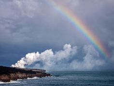 Rainbows, flowing lava, and gorgeous coastline.....all good signs that we are now in Hawai'i. The state of Hawai'i is often referred to as the rainbow state, simply because of the plethora of rainbows (in the sky, on license plates, sports teams, etc) that one can see here. But add a rainbow to lava flow and you are definitely on the Big Island of Hawai'i in Volcanoes National Park. This was shot on a long hike to see the lava flowing into sea, which is always an incredible experience. Have…